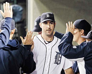 Detroit Tigers starting pitcher Justin Verlander walks in the dugout after being relieved in the eighth inning in Game 5 of baseball's American League championship series against the Texas Rangers Thursday, Oct. 13, 2011, in Detroit. (AP Photo/Paul Sancya)