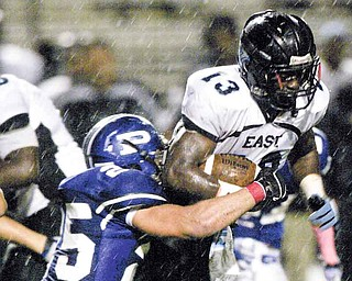 Youngstown East's George Leflore (13) is brought down by Poland's Mike Turnbull.