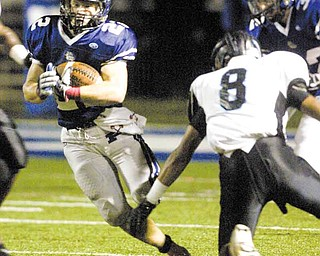 Poland's Jerry Lawman scrambles in the Bulldogs' Week 8 football game against the East Panthers on Thursday at Dave Pavlansky Field at Poland High School Stadium. The game was postponed by lightning, with Poland leading 14-7. The game has been rescheduled for today at 1 p.m. at Poland.