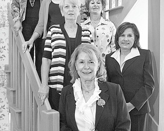 JESSICA M. KANALAS | THE VINDICATOR: Committee members for the Youngstown Federation of Women's Clubs' scholarship luncheon are, from top left, along the bannister, Yvonne Ford, Tamara Sigler, Rusti Puromaki and Barbara Higgins, and, from top right, Suzanne Brown, Catherine Campana and Debra Kostelic. The luncheon will take place at 11:30 a.m. Wednesday at the Holiday Inn in Boardman.
