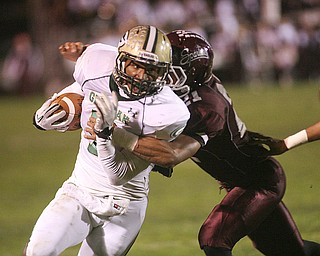 ROBERT  K.  YOSAY  | THE VINDICATOR --..Glenoak #7  Dashawn Hall is brought down as he makes his cut from the backfield for a loss by Bdm #21  Devin Campbell - during first quarter action - .Glen Oak vs Boardman at Boardman High School -..--30-..(AP Photo/The Vindicator, Robert K. Yosay)
