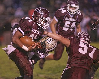 ROBERT  K.  YOSAY  | THE VINDICATOR --..Bdms #21  Devin Campbell breaks free from Glenoak #2  Lunden Butler as he follows the block of #57  Chris Riwniak   - #54 Justin Humphreys -  as Boardman was driving to the first score to tie the score -.Glen Oak vs Boardman at Boardman High School -..--30-..(AP Photo/The Vindicator, Robert K. Yosay)