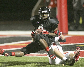 ROBERT K. YOSAY | THE VINDICATOR..Girards #3  Branden Byrd after catching a pass is dragged down by LaBrae #14  Justin Jenkins but he rolled into the endzone for a touchdown  . ...-30