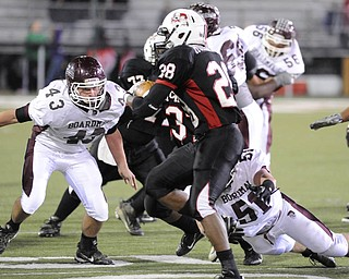 Boardman's #43 Joseph Mikesell and #51 Zach Machuga looks for the tackle of McKinley's #28 Sa'Veon Holloway on a running play.