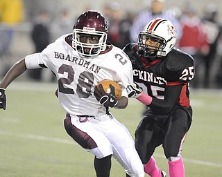 Boardman running back #28 Ivan Adu Poka looks for the corner while McKinley defensive back #25 Ruben Burrows goes for the tackle.