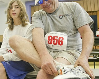 William D. Lewis|The Vindicator   Before start of Peace Race Sunday .Joe Sanders and his stepson Josh Westhead prepare at Kirkmere school. They are from North Jackson.