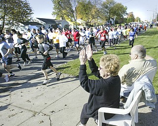 William D. Lewis|The Vindicator Dave and Virginia Adams watch the tart of Peace Race Sunday from their front yard on Kirk Rd.