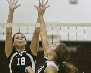 William D. Lewis|The Vindicator Salem's #6 NO NAME IN PROGRAM shoots the ball over the net while Canfield's Holly Rolla defends Thursday at Boardman.