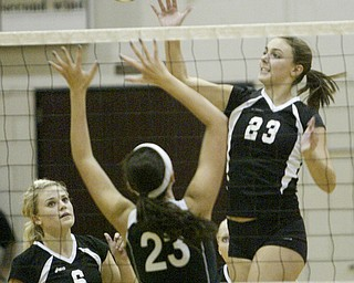 William D. Lewis|The Vindicator Canfield'sHannah Milstead #23 shoots as Salem's Lindsey Foster defends. At left is Canfield's Ellie Rafoth.