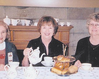 Preparing for the Austintown Historical Society's Christmas Tea are, from left, Rae Jeanne Mollica, Marge Goldner and Joyce Pogany.