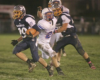 ROBERT  K.  YOSAY  | THE VINDICATOR --..McDonalds #29  Steven Vidman  cuts by Western Reserves #23 Jon Timko  as he goes for a first down. during first half action.Western Reserve Blue Devils ( white) vs McDonald Blue Devils at McDonald ..--30-..(AP Photo/The Vindicator, Robert K. Yosay)