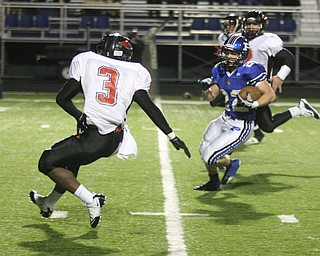 FOOTBALL - (22) Jerry Lawman makes a move on (3) Bryce Jackson Friday night in Poland. - Special to The Vindicator/Nick Mays