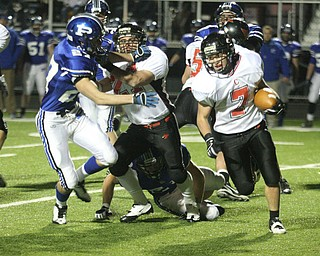 FOOTBALL - (7) Mike Ross tries to get around the end as (27) Ben Angelo blocks (27)Anthony Kosec Friday night in Poland. - Special to The Vindicator/Nick Mays