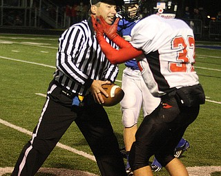 FOOTBALL - (32) Connor Loze of Canfield tells the ref that he had the ball Friday night in Poland. - Special to The Vindicator/Nick Mays