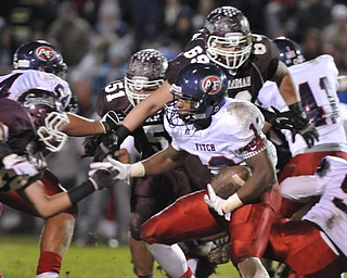 Fitch running back #13 Will Mahone looks for room to run around boardman defenders #44 Shawn Fiffick and #69 Zack Zidian.