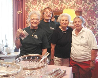 Upton House garage sale planned: Liz Clark, Sandra Sarsany, Dottie Sabey and Rita Hoppe Darling help prepare for the annual Upton House garage sale, planned for 9 a.m. to 4 p.m. Nov. 18 and 19. A variety of items will be on sale in the garage, kitchen and large dining room. The house is at 380 Mahoning Ave., downtown Warren. On Dec. 2, the Upton Open House will take place from 6 to 8 p.m. Decorated in holiday splendor, the house will be open to the public at no charge. On Dec. 9 through 11 story time with Mrs. Claus, $10 per child, will be available. Reservations are required by Nov. 30. Reservation forms and more information can be found online at www.uptonhouse.org, or call 330-395-1840.