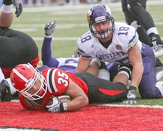 ROBERT K. YOSAY | THE VINDICATOR...YSU  #35  Jamaine Cook dives into the endzone as WIU  #18 Tim Franken can only look on - as YSU vs Western Illinois - homecoming at YSU and a win 56-14 ......-30