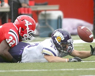 ROBERT K. YOSAY | THE VINDICATOR..Big turnover as YSU  #32 Jordan Thomas makes #16 for WIU Myers Hendrickson cough upthe punt. the  Penguins recovered and scored. .YSU vs Western Illinois - homecoming at YSU and a win 56-14 ......-30