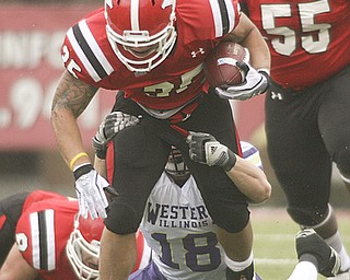 ROBERT K. YOSAY | THE VINDICATOR..Jamaine Cook YSU  drags WIU Tim Franken as Jamaine gets a first down during first quarter action..YSU vs Western Illinois - homecoming at YSU and a win 56-14 ......-30