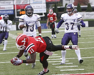 ROBERT K. YOSAY | THE VINDICATOR...#11 Kevin Watts pulls in a Kurt Hess 17 yard pass and dives into the endzone as WIU  #13 Jonathon Rollins  and #37 Ethan Bachinski looks on  YSU vs Western Illinois - homecoming at YSU and a win 56-14 ......-30