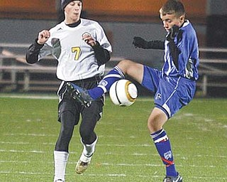 Andrew Batchelor (7) of Crestview battles Chippewa's Zach Beals for the ball during Tuesday's match.