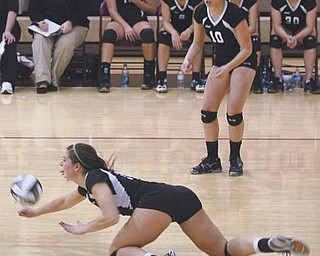 Canfield senior Abby Malsch dives for the ball during the second game of the Division II regional volleyball semifinal against Beaumont on Thursday in Stow. The Cardinals' season came to an end at the hands of the Blue Streaks, who won 3-0.