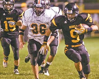 Crestview's Collin Gilbert (9) races for a big gain during the Rebels' game against the Springfield Tigers at Crestview Stadium. The Rebels square off tonight against Cuyahoga Heights in the Division V playoff s — a matchup in which both teams combined have 25 playoff appearances.