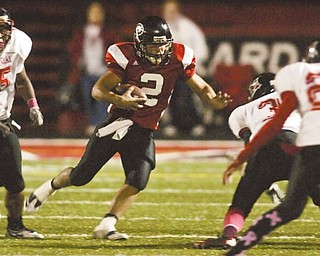 Girard quarterback Dan Graziano (2) runs the ball against the Campbell Memorial defense. The Indians are headed to the Division IV playoff s Saturday against Cleveland Central Catholic, a contest that pits Girard's strong offense against the Ironmen's strong defense.