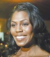 Reality-TV personality Omarosa Manigault-Stallworth spoke with reporters Thursday at the Greater Warren-Youngstown Urban League dinner in Niles.