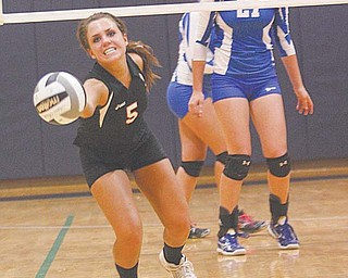 Mineral Ridge's Lea Whitmer (5) makes a play on the ball during a Division IV regional volleyball semifinal Thursday against Jackson-Milton at Solon High School. The Rams downed the BlueJays, 3-0, to advance to the regional final on Saturday against Tuscarawas Central Catholic in Solon.