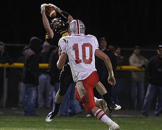FOOTBALL - (8) Matt Hardenbrook of Crestview pulls down a pass over (10) Jordan D'Orazio during thier game Friday night in Crestview. - Special to The Vindicator/Nick Mays