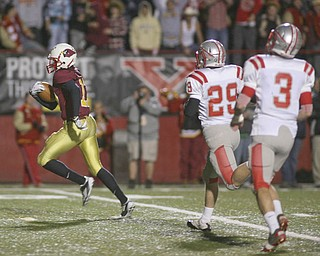ROBERT  K.  YOSAY  | THE VINDICATOR --..Mooneys #17 Quincy Jones leaves  Canal Fultons #29 Mason Tesch and #3  Mike Pribonic  in the dust as he scampers for a touchdown during first quarter action ..Cardinal Mooney Cardinals vs Canal Fulton Northwest Indians at Stambaugh Stadium in the Regional Quarterfinals .--30-..(AP Photo/The Vindicator, Robert K. Yosay)