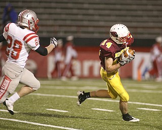 ROBERT  K.  YOSAY  | THE VINDICATOR --..Mooneys #14  Ryan Farragher pulls in a pass  and takes it down to the four yardline  as as Canal Fultons #29  Mason Tesch can only watch..Cardinal Mooney Cardinals vs Canal Fulton Northwest Indians at Stambaugh Stadium in the Regional Quarterfinals .--30-..(AP Photo/The Vindicator, Robert K. Yosay)