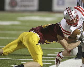 ROBERT  K.  YOSAY  | THE VINDICATOR --..Mooneys #24 Ryan Farragher ties up #7 Dan May for the Indians as he pushes him out of bounds short of a first down..Cardinal Mooney Cardinals vs Canal Fulton Northwest Indians at Stambaugh Stadium in the Regional Quarterfinals .--30-..(AP Photo/The Vindicator, Robert K. Yosay)