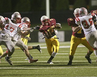 ROBERT  K.  YOSAY  | THE VINDICATOR --..Big Whole  #3 Mooneys Roosevelt Griffin  takes off for  a first and ten as his teamates open a big whole during first half action..Cardinal Mooney Cardinals vs Canal Fulton Northwest Indians at Stambaugh Stadium in the Regional Quarterfinals .--30-..(AP Photo/The Vindicator, Robert K. Yosay)