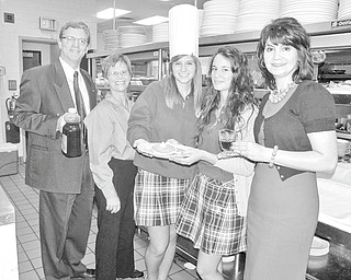 Getting ready to serve up warm, fluffy pancakes on Nov. 13 are, from left, Don Foley, Youngstown Rotary member; Carol Sherman, Rotary member and chairwoman of the pancake breakfast committee; Natalie Parks, Ursuline High School Interact Club; Margherita Bellu, Rotary exchange student from Italy; and Carolyn Korenic, director of alumni and advancement, Ursuline High School.