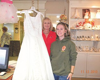 Operation Wedding Gown: Treasured Moments Bridal & Formal, 80 Boardman-Poland Road, Boardman, is participating in Operation Wedding Gown on Nov. 11 in honor of Veterans Day. The event is part of Brides Across America, a national charitable organization that provides free gowns for military brides. Military fiancées are invited for interviews and refreshments that day. To qualify, they must be engaged and be on active duty in the military or have a fiancé on active duty in Iraq, Afghanistan, Bahrain, Libya or Japan. All military brides must show ID, copy of deployment papers, orders or other qualifying proof. Ann Hough, above, drove from Dublin, Ohio, to claim her free wedding gown during last year's event. For more information call Treasured Moments at 330-726-9144 or visit www.bridesacrossamerica.com.