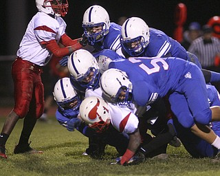 ROBERT  K.  YOSAY  | THE VINDICATOR --..big Sack led by #57 Sam Steininger  and a host of blue devils as they smother  Anthony Sywanyk the Vikings qb for a big loss..Regional quarter final at Western Reserve Stadium - Western Reserve Blue Devils  VS   Villa Angela St Joesph Vikings.--30-..(AP Photo/The Vindicator, Robert K. Yosay)