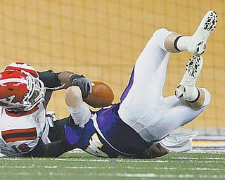 Youngstown State's Daniel Stewart (19) sacks Northern Iowa quarterback Jared Lanpher in Saturday's MVFC game at the UNI-Dome in Cedar Falls, Iowa. Despite losing 21-17, the Penguins' defense is starting to look like a playoff -caliber unit.