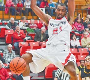 Youngstown State's Damian Eargle dunks during a game last season against Milwaukee at Beeghly Center. Eargle will be one of the Penguins' most-counted on players for the 2011-12 season, which tips off on Saturday night at Samford.