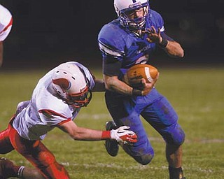 Western Reserve's Tim Cooper escapes a tackle attempt by Villa Angela-St. Joseph's Ryan Gallagher in the Blue Devils' playoff win. Saturday, Western Reserve will take on Malvern in Louisville.