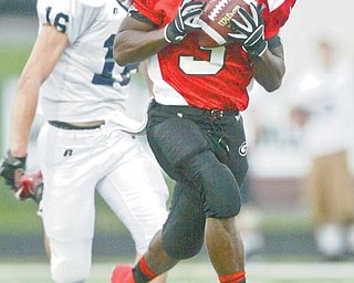 """Girard's Branden Byrd heads for the end zone after hauling in a pass from quarterback Dan Graziano during a regular-season game against Warren JFK. Byrd says the Indians defense has discovered a simple way to stop the opposition from scoring: """"If you wrap them up, they'll go down."""""""