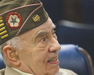 """Allen L. Wolkoff of Warren, with a stripe on his hat for every six months in Europe during World War II, talked about his Army experiences and said a Veterans Day service Friday at Temple El Emeth in Liberty """"is a nice thing."""""""