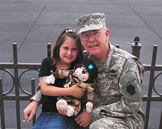 CW5 William T. Sweeney is shown here with Jessica Tirone, his granddaughter, in 2006. Sweeney lives in Boardman and served more than 30 years as an Army helicopter pilot.