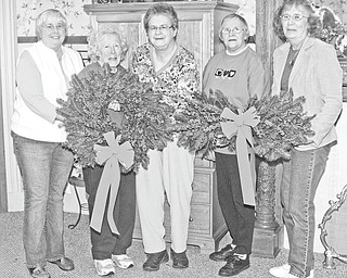 Nick Mays | Special to The Vindicator: Friends of the Children's Aid Society of Mercer County are planning a holiday fundraiser to support charitable Christmas giving. Members, from left to right, are Liz Bolster, Julie Anhalt, Shirley Young, Betty Hollobaugh, and Mary Calvin. They are showing off some of the wreaths that will be sold this year.