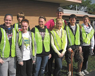 Keeping Kirk Road clean: Members of the Fitch Interact Club and the Rotary Club of Austintown met recently for their semiannual cleanup of Kirk Road from Route 46 to Whispering Pines Drive. This marked the 11th year for the project, in conjunction with the Mahoning County Green Team. From left to right, front, are Interact members Megan Miller, Spencer Skolnick, Samantha Eash, Lauren Ferguson and Zerek Bell, and David Dalvin of Canfield, and in back row are Tom Frederick and Alex DiFrancesco.