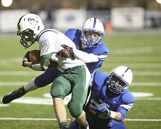 ROBERT  K.  YOSAY  | THE VINDICATOR --..Bg Stop as 22  Jon Timko on the bottom and #13  Parker Warren stop #5  Aaron Enold  after a frist down during first half action ..Regional quarter final at Western Reserve Stadium - Western Reserve Blue Devils  VS   Malvern Hornets at Louisville.--30-..(AP Photo/The Vindicator, Robert K. Yosay)