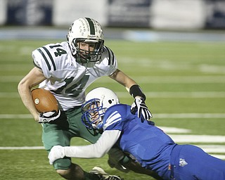 ROBERT  K.  YOSAY  | THE VINDICATOR --..Big run stopped #14 Malvern Travis Tucci is stopped by #3 WR Tim Cooper - ..Regional quarter final at Western Reserve Stadium - Western Reserve Blue Devils  VS   Malvern Hornets at Louisville.--30-..(AP Photo/The Vindicator, Robert K. Yosay)