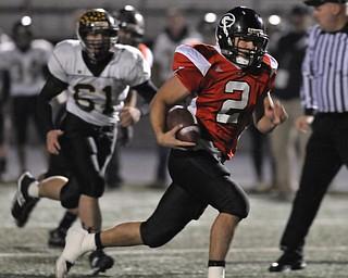 Girard quarterback #2 Dan Graziano runs away from Black River defender #61 Ralph Koons for the touchdown.