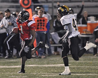 Girard running back #1 Ahmad Eggleston runs away from Black River defender #42 Donatius DeMarco on his way to the endzone for the touchdown.